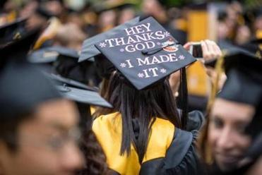Christina Gibbs 22, wore a decorated cap at Framingham State University's commencement ceremony.